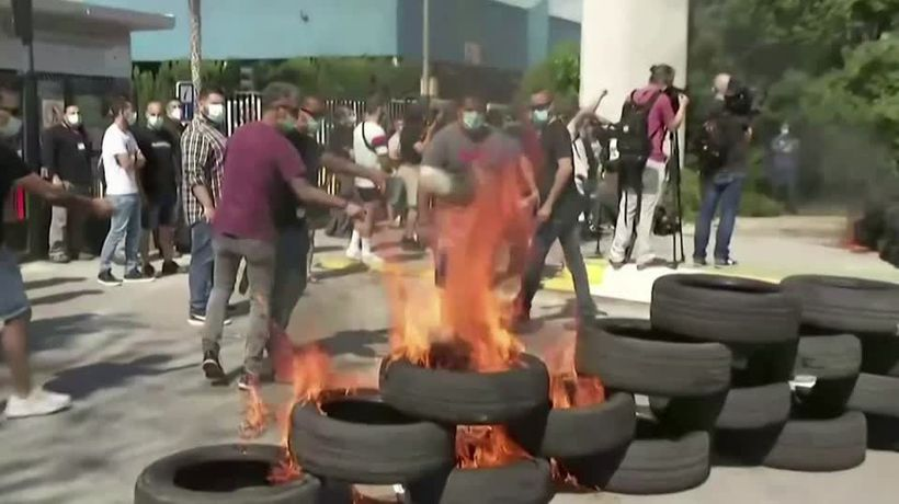 Protests flare as Nissan shuts plants