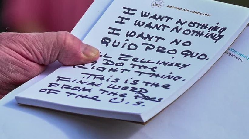 Trump's notes to himself caught on camera: 'I want nothing'