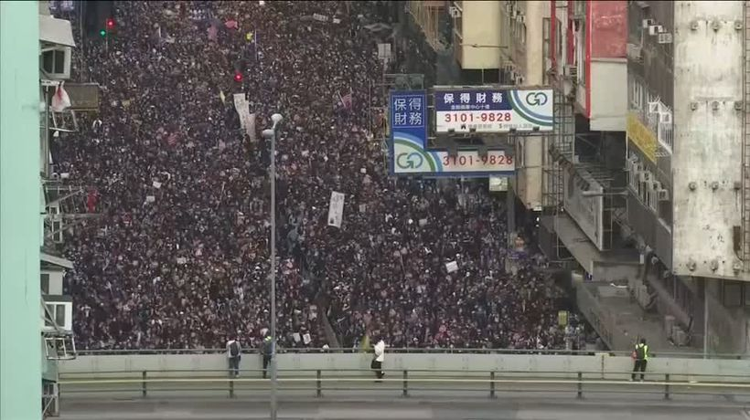 Thousands march in Hong Kong as government urges calm