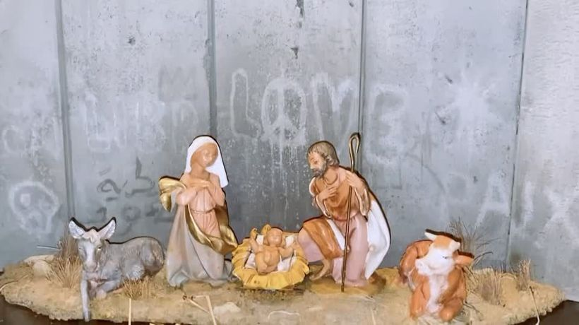 Mystery artist Banksy leaves a political nativity in Bethlehem