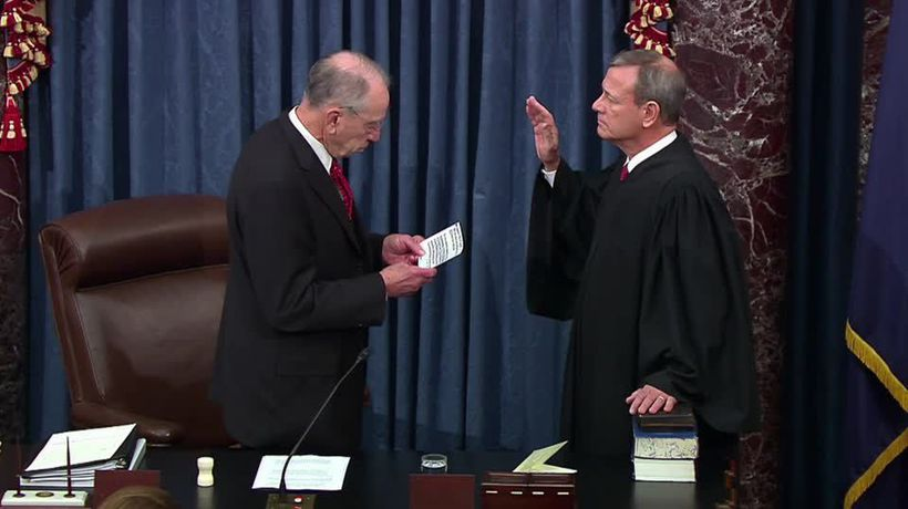 Senators and chief justice sworn in as Trump impeachment gets under way