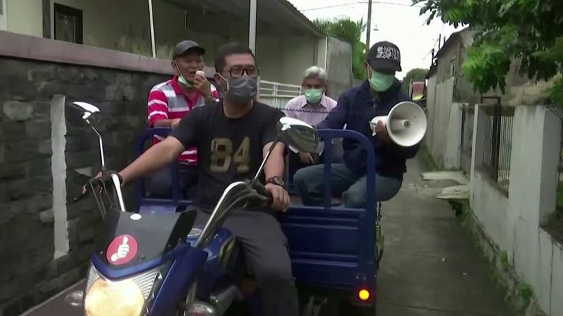 'Obey the rules': Indonesia's doctor shouts from tricycle