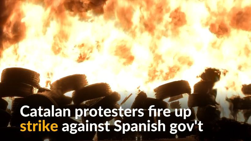 Catalan independence protesters burn tires and block roads in strike