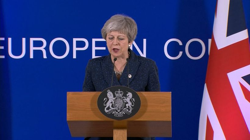 May wins Brexit reprieve, with a catch