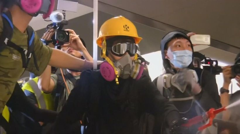 Hong Kong protesters demand action on mob attack