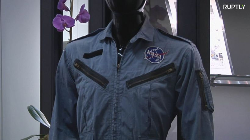 Out of this world! Neil Armstrong's possessions go under the hammer