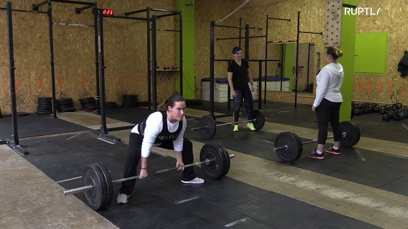 Russian powerlifting champion searches for her parents after 30 years of separation