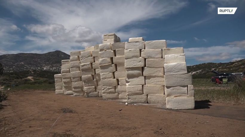 Artist builds CHEESE wall on Mexican border to 'Make America Grate Again'