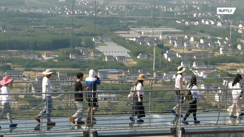 Don't look down! Tourists brave world's longest glass bridge in China