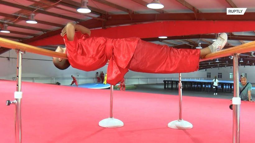 Shaolin monks perform BACKBREAKING feats of strength at Beijing demo