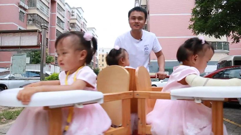 Chinese father creates spinning stroller for baby triplets