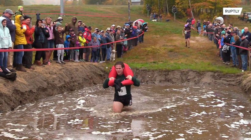 Couples race for beer and cash as Maine wife-carrying contest turns 20