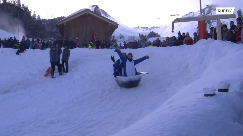 Greta Thunbergs and mountain monkeys ride a bathtub down a mountain in this Swiss race