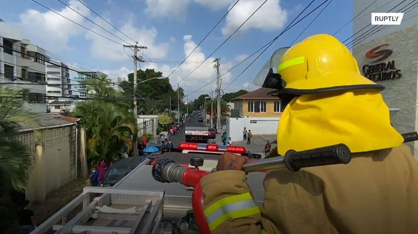 Firefighters ready to douse with water those who do not keep social distance