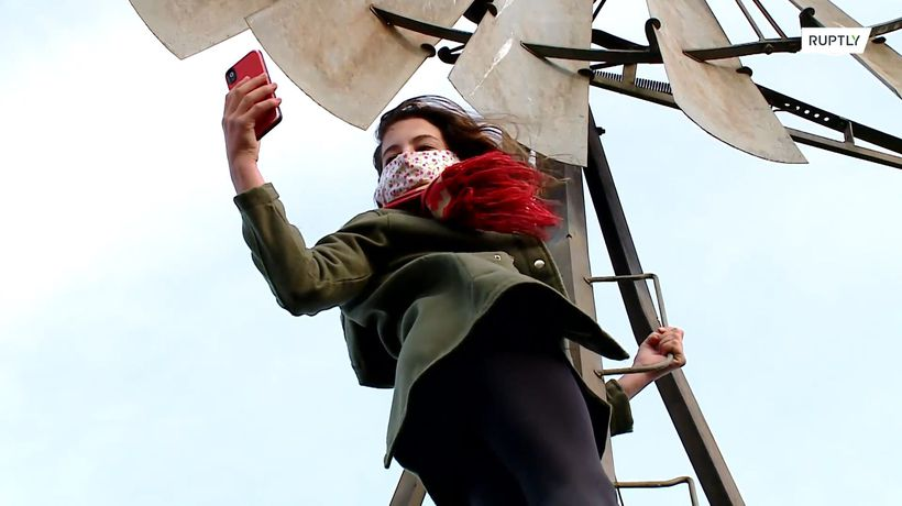 Girl climbs windmill to send homework via Internet during lockdown