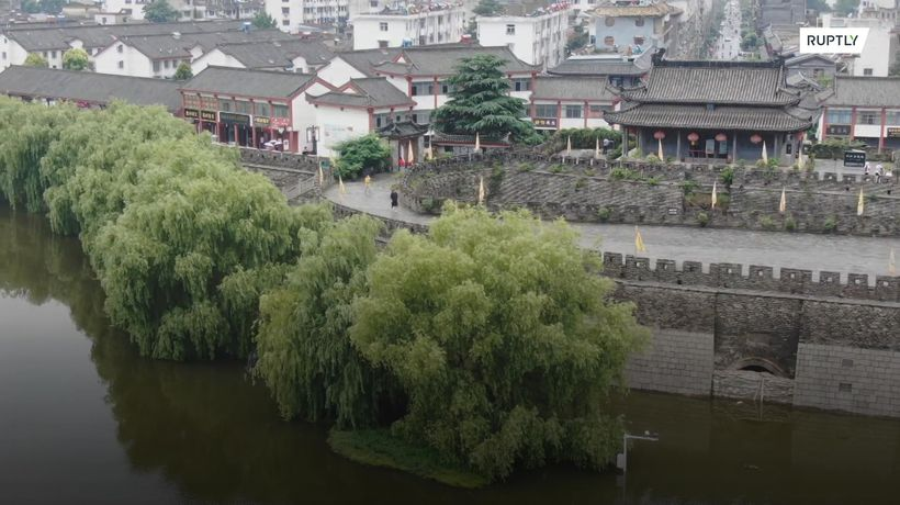 Ancient Chinese city seals gate amid worst flooding in decades