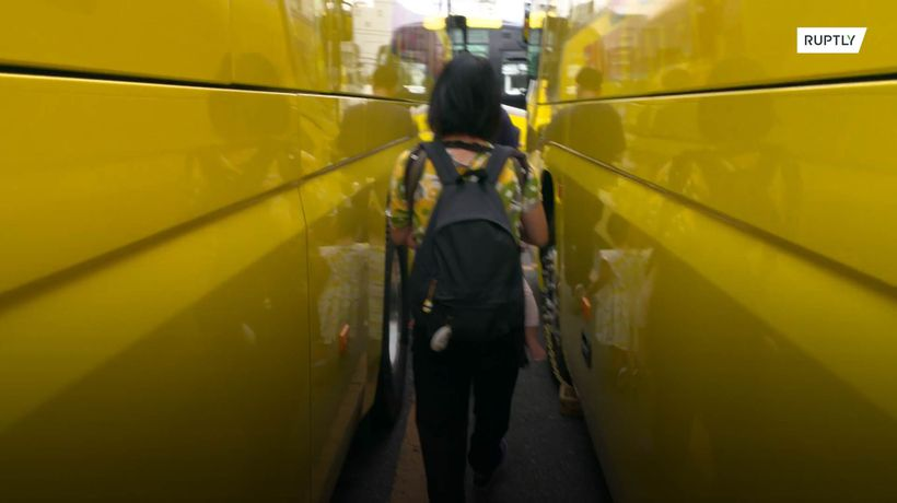 Idle tour buses turned into giant maze in Tokyo