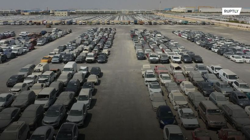Abandoned luxury cars wait for new owners in Dubai scrapyard
