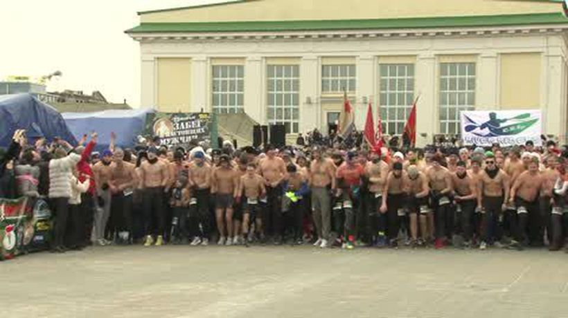 Topless daredevils compete in 'Real Man Race' in Minsk