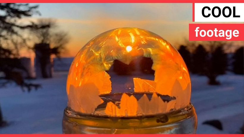 Icy conditions cause a water ball to instantly freeze in a mesmerising pattern
