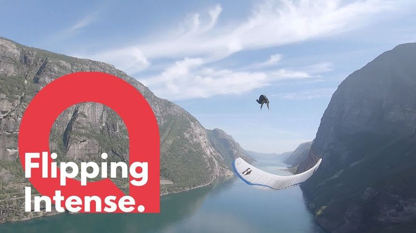 Daredevil performs front flips - while paragliding