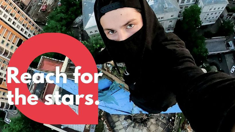Daredevil urban explorer scales a building that features a star