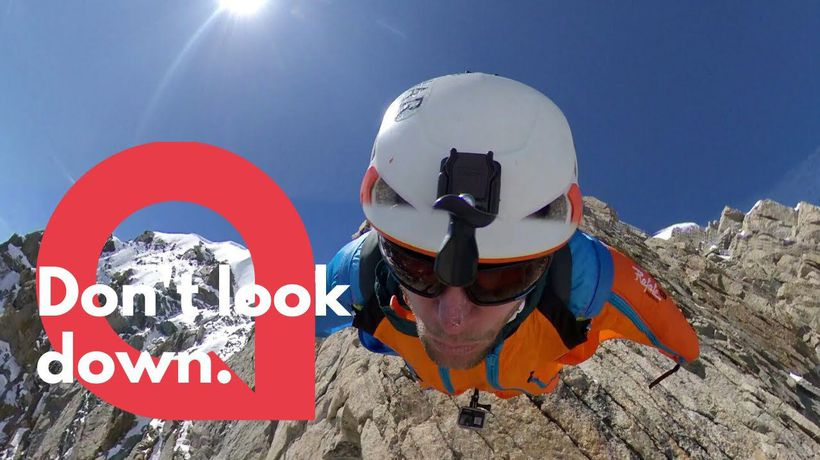 Base jumper leaps from the top of the peak of mountain