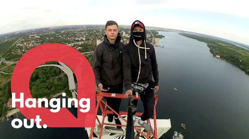 Shocking moment a daredevil teenager climbs an abandoned crane