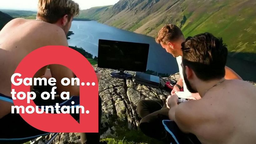 Group of gamers set up their PlayStation 4 on top of a Lake District peak