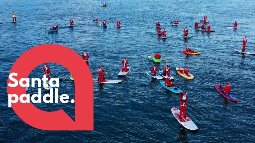 Fifty Santas take to the sea on paddleboards and kayaks for charity