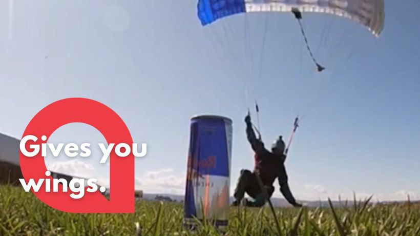 Skilled skydiver snatches a can of Red Bull as he lands