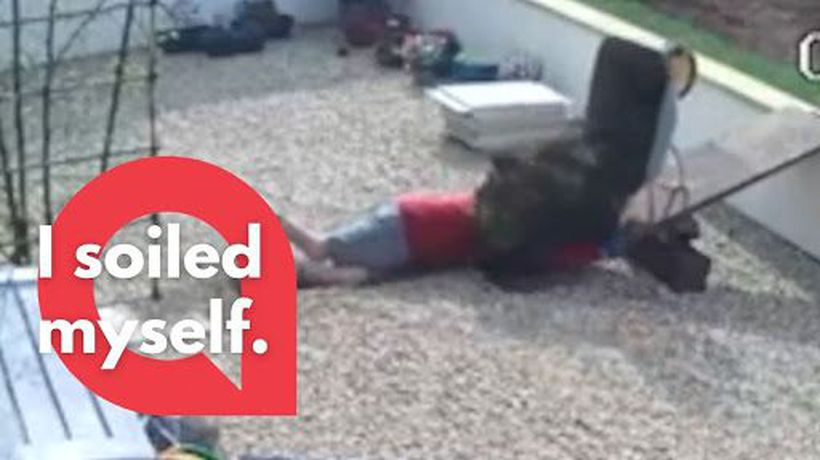 Gardener slips down a walkway - tipping a wheelbarrow of soil onto his head!