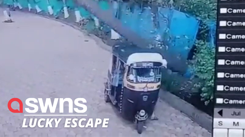 Tuk-tuk driver narrowly escapes injury after a coconut tree crushes his vehicle in West Maharashtra,