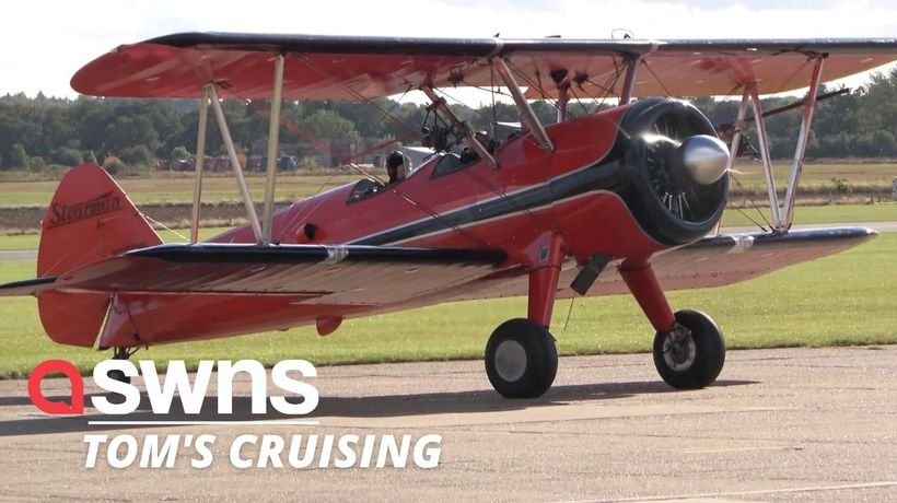 Tom Cruise flies a WWII biplane amid reports he's practising for dog fight scenes in Mission Impossi