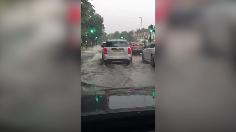 London streets flooded as torrential rain hits capital