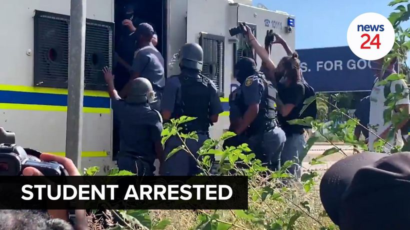 WATCH | Police arrest Wits student as protesters barricade Joburg main road