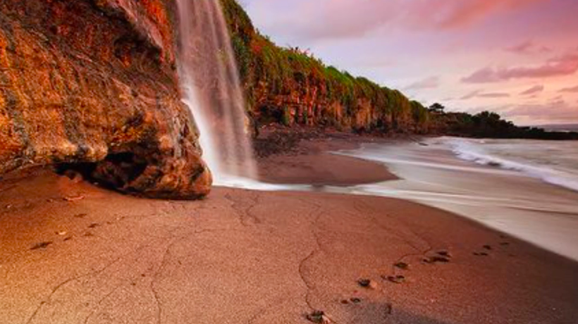 This Waterfall Falls Onto A Stunning Bali Beach & It's Incredible!