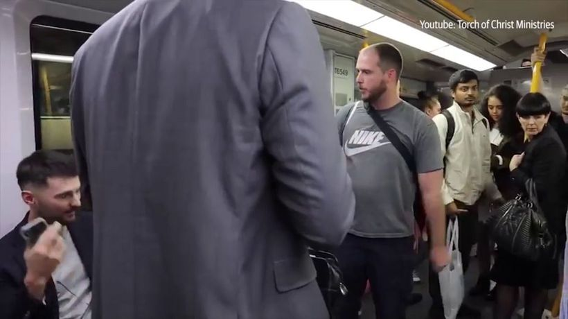 Passengers on Sydney train shut down anti-abortion preacher