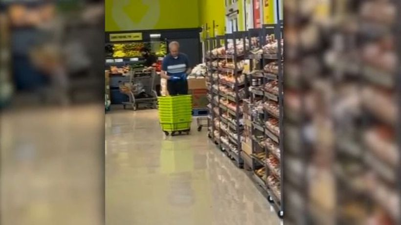 Cleaner seen 'spit shining' shopping baskets
