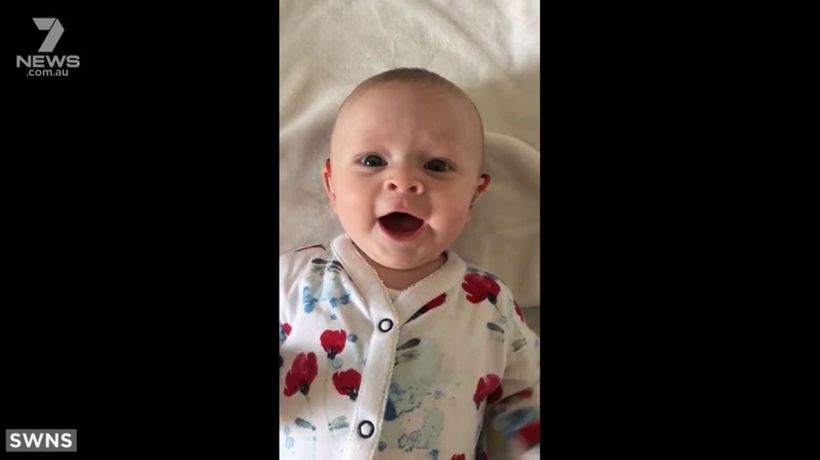 Moment deaf baby's hearing aid is turned on