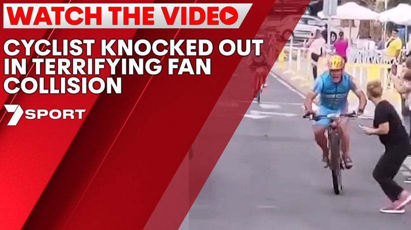 Cyclist knocked out in terrifying fan collision