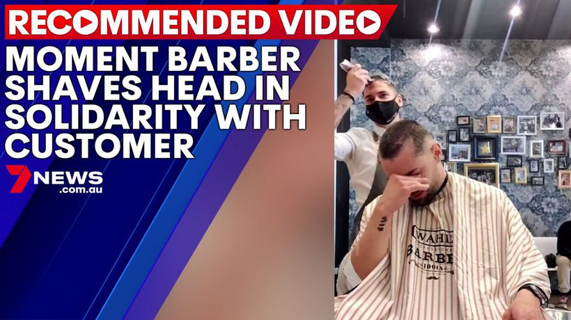 Heartwarming moment barber shaves head in solidarity with colleague