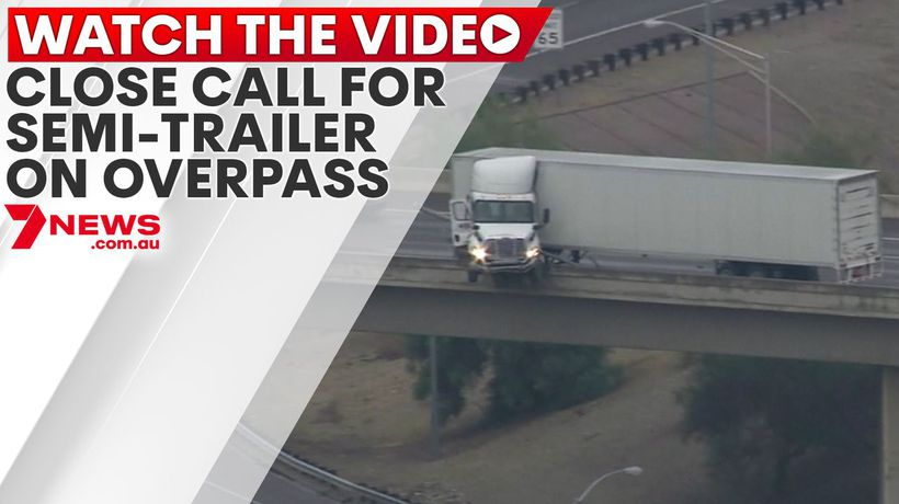 Close call for semi-trailer on overpass