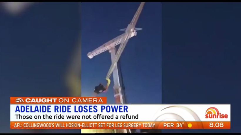 Couple left hanging upside after carnival ride loses power