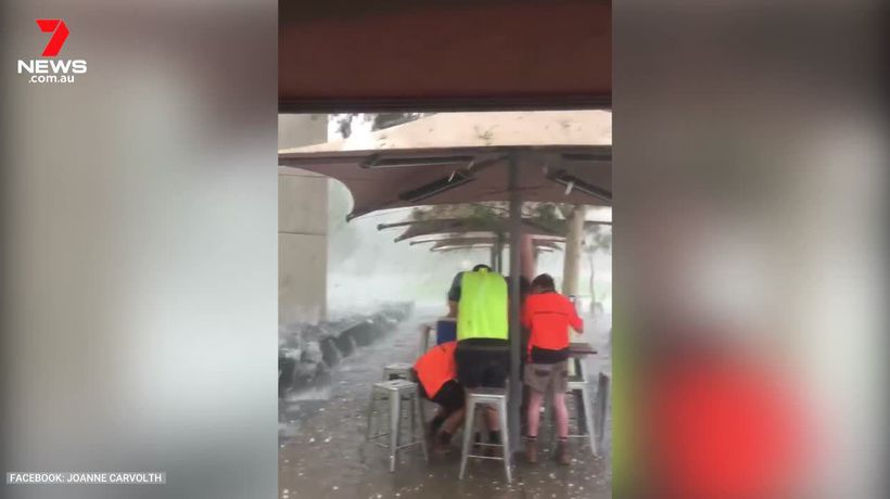 People huddle for safety from hailstorm