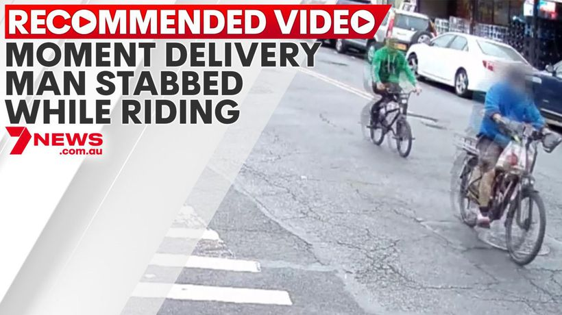 Moment delivery man stabbed on bike