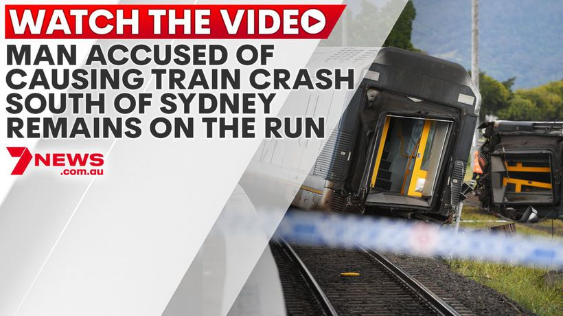 Man accused of causing train crash south of Sydney remains on the run