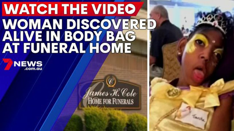 Funeral home worker finds woman alive in body bag