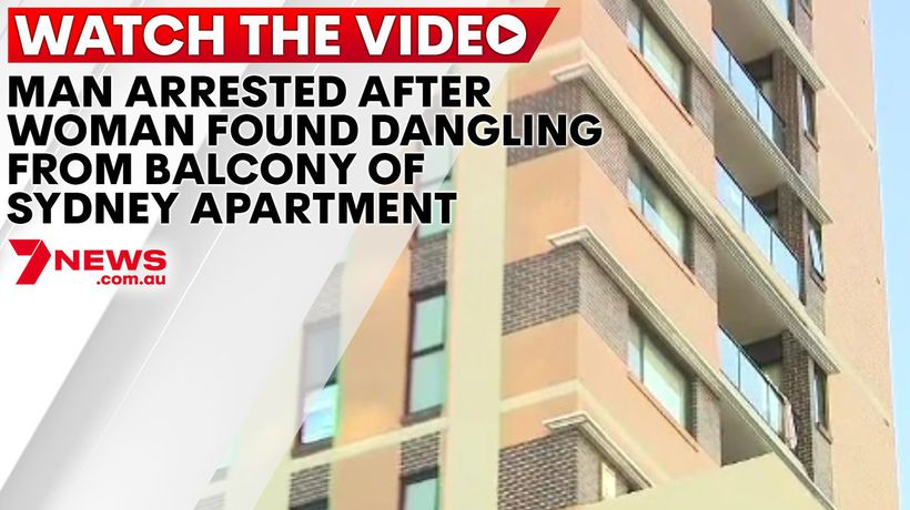 Man arrested after woman left dangling from balcony of Sydney apartment