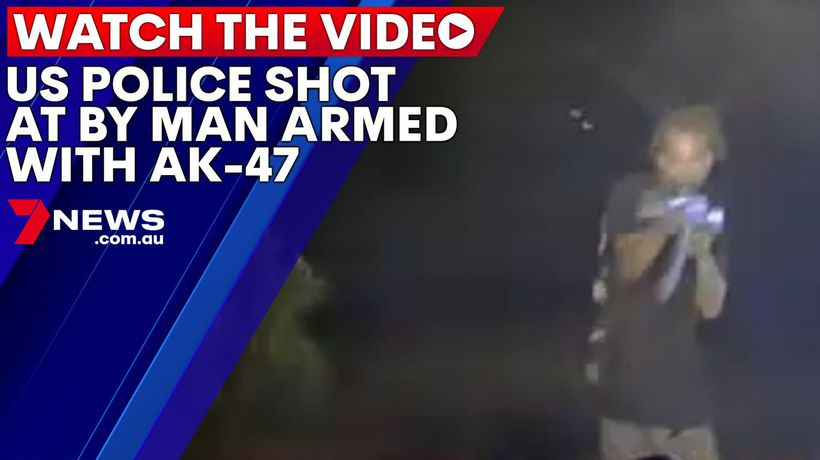 US police shot at by man armed with AK-47